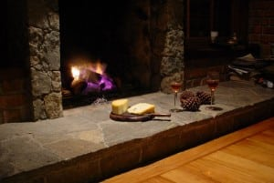 fireplace with cheese and wine
