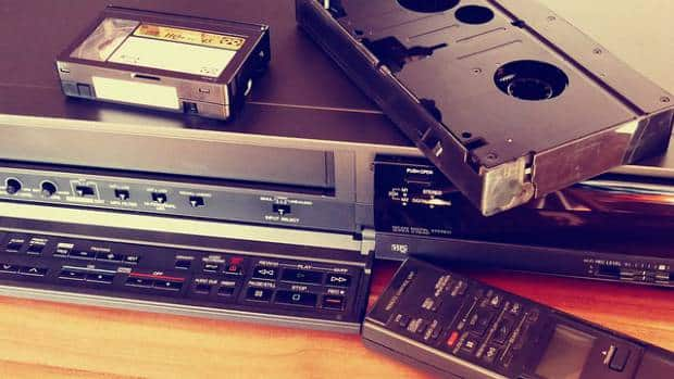 image of an old vcr with tapes and remote control